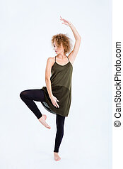 Young woman with curly hair dancing
