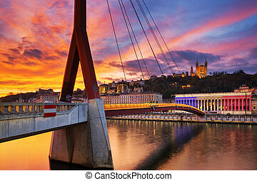 View of footbridge on Saone river at sunset