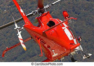 Mountain rescue helicopter taking off seen from the back