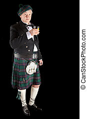 Scottish toast with whisky - Scotsman in kilt making a toast...