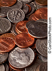 loose change - pennies, nickles, dimes, and quarters macro...