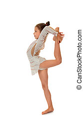 Beautiful young gymnast - Young Ballerina dressed in sports...