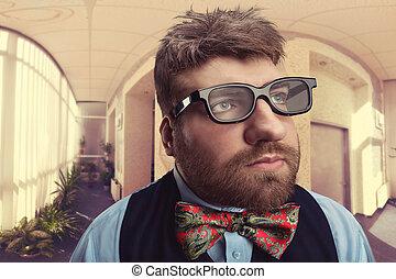 Strange nerd  - Office nerd in glasses looks aside