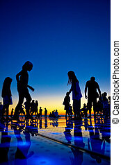 People silhouette on colorful sunset