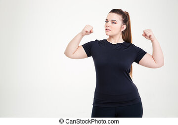 Beautiful fat woman showing her biceps - Portrait of a...