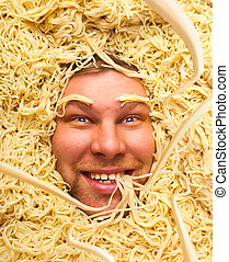 Man's face in pasta, closeup - Happy face of man in pasta