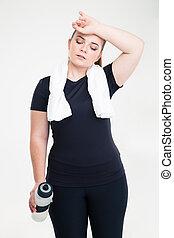 Portrait of a tired fat woman in sports wear standing...