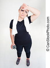 Tired fat woman in sports wear - Full length portrait of a...