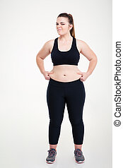 Woman pinches fat on her belly - Full length portrait of a...