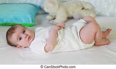 Baby boy - Four months old baby lying on his back and...