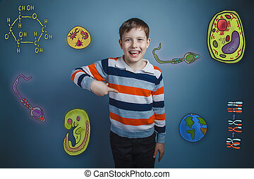 boy laughing and pointing - teenage boy laughing and...