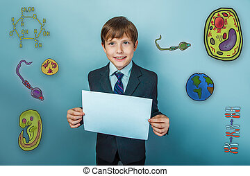boy smiling - Teenage boy smiling businessman holding a...