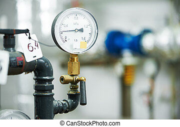 manometer in boiler room - Closeup of manometer, pipes and...