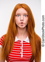 Funny redhead girl fooling aroung and making funny faces -...