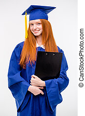 Portrait of pretty cheerful girl in gown and graduation cap...