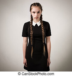 Beautiful Teenage Girl With Plaits Dressed In Black - Studio...