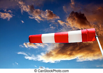 Windsock aand stormy clouds - horizontally flying windsock...