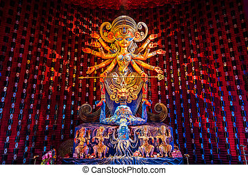 Durga idol - Colorful idol of Goddess Durga being worshipped...