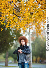 Woman waiting for somebody outdoors - Portrait of a young...
