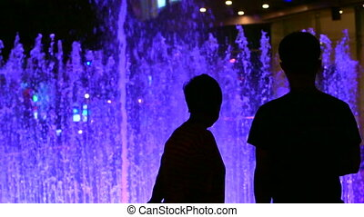 Silhouette people night fountain