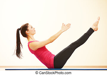 Woman doing stretching excercises in gym