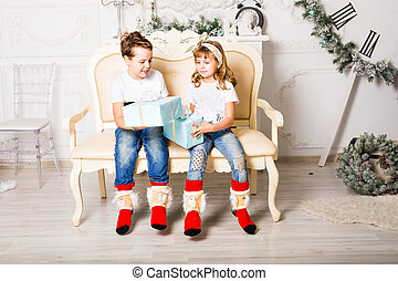 Happy  kids with gift box in the living room at home