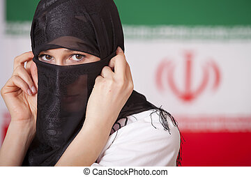 muslim woman over iran flag - muslim woman in front of iran...