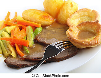 Roast beef and Yorkshire puddings - Traditional british meal...
