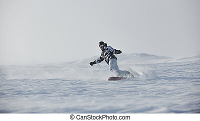 freestyle snowboarder jump and ride free style at sunny...