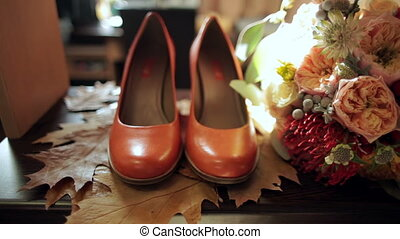 bridal bouquet and bride's shoes on autumn leaves - bridal...