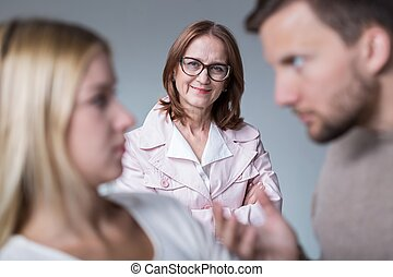 Bad mother-in-law and her son arguing with wife
