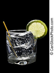 Club Soda or Gin / Vodka Tonic Cocktail on a black...