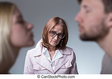 Unhappy mother-in-law - Image of unhappy mother-in-law and...