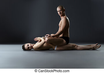 Yoga. Man sitting on nude woman in lotus position
