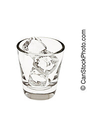 Empty glass tumbler with ice cubes on a white background