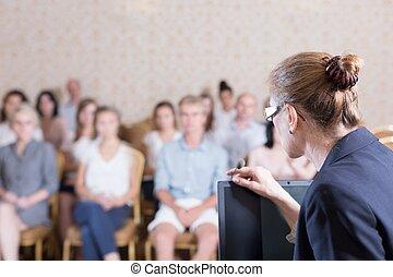 Speaking into the microphone - Public speaker is speaking...