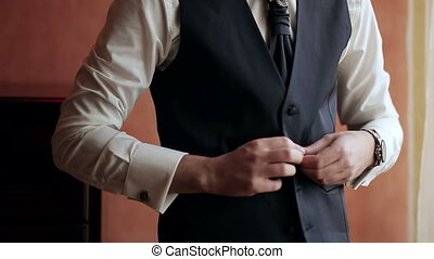 stylish man dress shirt, suit and vest near the window