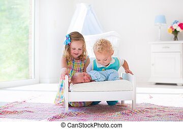 Little boy and girl meet new sibling - Cute little boy and...