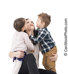 two little kids having fun with their mother