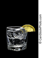 Club Soda or Gin Vodka Tonic Cocktail on a black background...