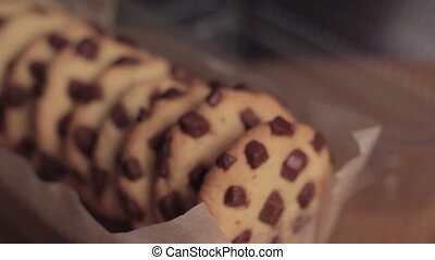 Chocolate chip cookie isolated in packaging. Slider motion.