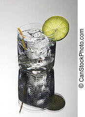 Club Soda or Gin / Vodka Tonic Cocktail on a grey background