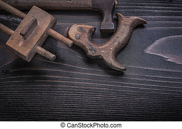 Horizontal view of longstanding hand saw marking gage claw...