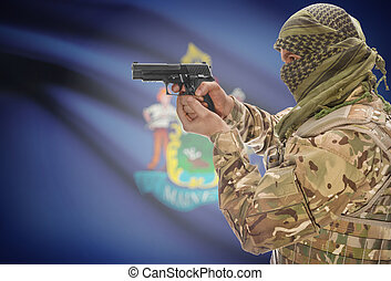 Male in muslim keffiyeh with gun in hand and flag on background - Maine