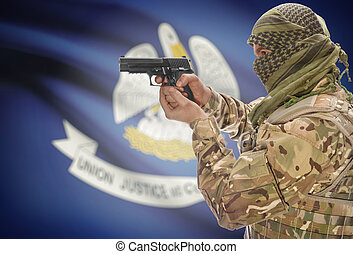 Male in muslim keffiyeh with gun in hand and flag on background - Louisiana