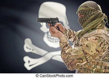 Male in muslim keffiyeh with gun in hand and flag on background - Jolly Roger - symbol of piracy