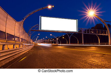 Big white billboard on the night highway