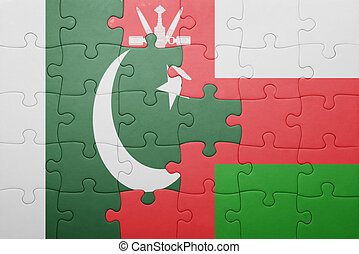 puzzle with the national flag of oman and pakistan