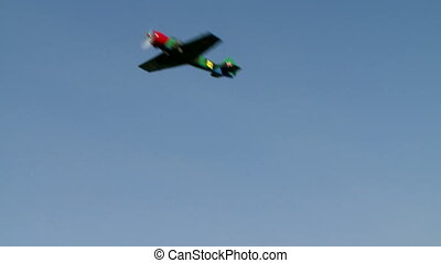 Single-engine plane performs aileron roll maneuver - View of...