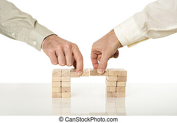 Conceptual image of business merger and cooperation - two...